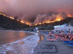 Burning at the beach: Greeks watch wildfire approach Citizens of the village of Lithi find refuge at the beach as a wildfire burns on a mountain next to it, in the island of Chios, Greece, Aug. Watch The World Burn, End Of The World, Chios Greece, Destinations, The Beach, Les Continents, All Nature, Extreme Weather, Natural Disasters