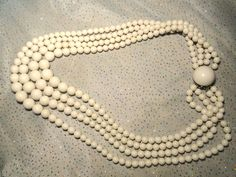 Vintage Lucite White Beaded Necklace Marked Japan. Starting at $8 on Tophatter.com!