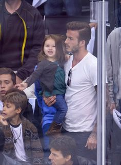 Pin for Later: 14 Crazy-Cute Harper Beckham Photos From Over the Years  In May 2013, Harper flashed a big smile at an LA Kings hockey game.