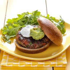 Salsa Black Bean Burgers Recipe - hearty bean burger with guacamole. (Omit the sour cream & substitute the egg with tofu or oats).