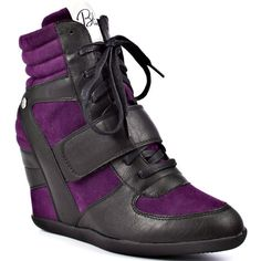 If you're bored of the same old look then you'll be blown away by this unique wedge.  Blink introduces the Ajaxx lace up sneaker, complete with a multi color upper of synthetic cognac and purple fabric.  Laces and Velcro adorn the front and accent the 1 inch rubber platform and carefully hidden hot 3 inch wedge.