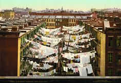 """On """"laundry day"""" in the late 1800s and early 1900s, New York City residents dried their clothes on clotheslines that stretched between buildings. When the weather was wet, residents had to string up lines inside their already crowded apartments. Washing was done by hand."""