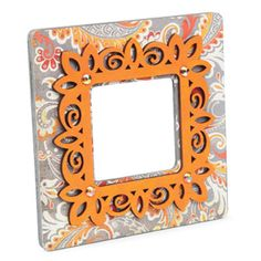 Cool use of the unfinished laser cut frames from Michael's, adding on top of a simple square wooden frame