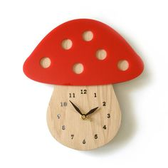 This charming mushroom clock would be perfect for a fairly tale themed room. Made out of red acrylic and white oak body with numbers. FEATURE: • Size: 9 x 8.5 inches • Made of white oak veneer and red
