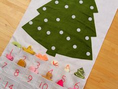 Velcro Advent Calendar Tree. Take the day's decoration & stick it to the tree...  http://www.purlsoho.com/purl-soho-goods/purl-soho-patterns/advent-calendar-pattern-1.html