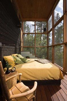 The bedroom with glass wall wooden floor and wooden furniture