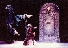 Christmas Carol Ebenezer Scrooge Headstone | The Ghost of Christmas Yet-to-Be shows Scrooge his grave.