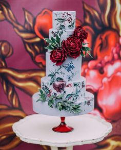 This painted, pale blue cake with tons of flowers. | 25 Incredibly Beautiful Wedding Cakes That Won 2015