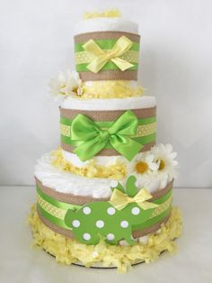 Bunny Diaper Cake, Spring Theme Baby Shower Centerpiece, Easter Decorations by AllDiaperCakes on Etsy https://www.etsy.com/listing/265282463/bunny-diaper-cake-spring-theme-baby