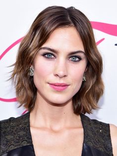 Alexa Chung's dark eye liner and rosy lip are stunning with her simple wavy hair
