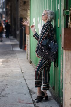 95be36eea30a9 striped suits for fall with henri bendel backpack and gucci loafers