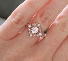 Vintage Inspired Engagement Rings by PenelliBelle ~ The Charlotte features a 14K rose gold diamond halo setting. Set with 1.2 ct genuine Morganite and accented with .25 ct in natural diamonds