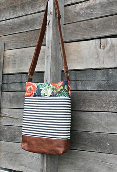 A fun twist on my best selling crossbody bag! It is made from 100% cotton designer fabrics, and beautiful genuine leather. It is lined with a sturdy cotton fabric in a neutral color. It is the perfect size for everyday use! Cute AND practical! ***Measures 11 in (w) and 13 inches (h).