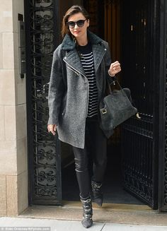 Early riser: Miranda was seen exiting her apartment building in Manhattan before heading to the airport