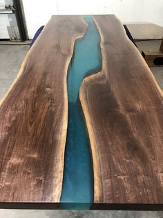 Beautiful one-of-a-kind Black Walnut Ecopoxy River Table. This Walnut table is a rare find due to the amazing natural rose pink and multiple shades of brown that are in both pieces, that is very hard to get in large Walnut pieces and maintain that natural color from when the wood is