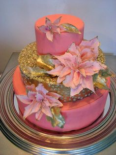 Shimmering pink and glittering gold make this cake a stunning combination with hand made and dusted poinsettias and gold leaves. Cakes by Cakes in Art, King George, VA Coral Wedding Cakes, Pink And Gold Wedding, Unique Wedding Cakes, Blush Winter Wedding, Winter Wedding Inspiration, Christmas Inspiration, Wedding Ideas, Traditional Wedding Cakes, Gold Cake