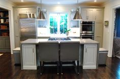 Poured concrete for the top of the island, which was molded to wrap around the base of the cabinets on each side like a parsons desk