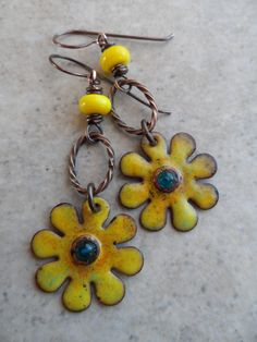 Beautiful enameled copper flower charms, expertly handcrafted by Marlene Kazor Quigley, are perfectly paired together with mini lampwork beads,