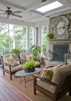 This patio cover makes the space an extension of the home. Notice the fan and skylight.