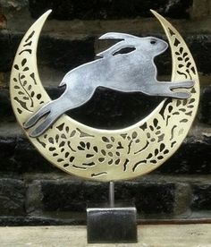 Leaping hare in brass crescent