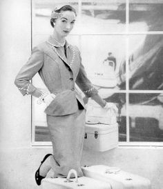 Evelyn Tripp in travel suit from Peck & Peck tailored by Izod of London, Vogue, March 1953