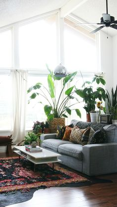 Take inspiration from vintage design for your living room makeover with help from this eclectic space. From the warm aztec rug and abundance of fresh indoor plants, to the simplistic furniture and retro patterned pillows, this design really has it all!