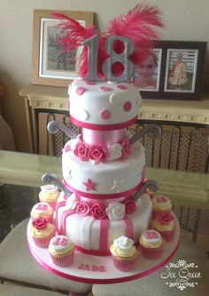 3 tier 18th birthday cake in pink white & silver with cupcakes Designer wedding & celebration cakes in Liverpool, St Helens, Wigan & Warrington www.icequeencakes.co.uk