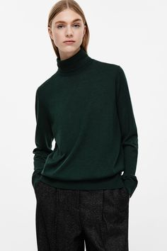 COS image 8 of Merino wool high-neck jumper in Forest Green