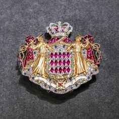 "The coat of arms of Monaco brooch, set with diamonds, emeralds, sapphires, rubies and in platinum, gold, was displayed at the Cartier exhibition ""Cartier, Le style et l'histoire"" in Grand Palais, Paris in 2013. The brooch comes from the collection of the Prince's Palace of Monaco. http://socker-zucchero.livejournal.com/121021.html"