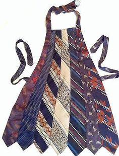 Apron made from old neck ties > I need to do this with all of my dad's old ties.he loved to cook Old Neck Ties, Old Ties, Fabric Crafts, Sewing Crafts, Sewing Projects, Necktie Quilt, Necktie Purse, Genius Ideas, Blog Couture