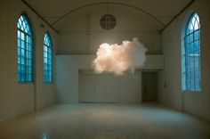It's not photoshop, it's real. By the Dutch artist Berndnaut Smilde who creates indoor clouds by using a smoke machine.