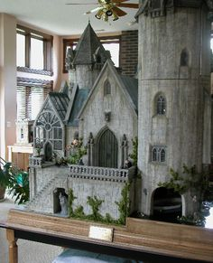 This miniature (shown is a greenhouse in Hogwarts) is by the same lady who made the miniature of the Burrow that is circulating. You have to go visit this page, there are so many amazing pictures and more sets, along with an interview of her about her miniatures and her process of making them. It's amazing!