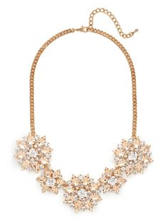 The glamour of this collar is unmistakable, just look at the warm champagne colored crystals arranged in a lovely floral motif it features.