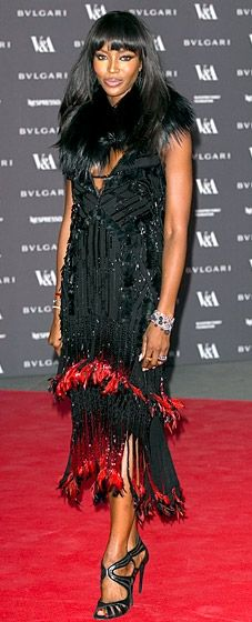 Naomi Campbell shuts it down in a Roberto Cavalli dress at the Glamour of Italian Fashion Exhibition