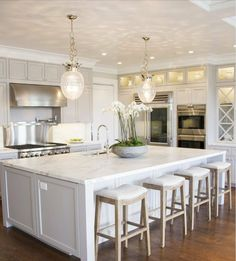 white kitchen... the patterns those lights cast on the ceiling though!
