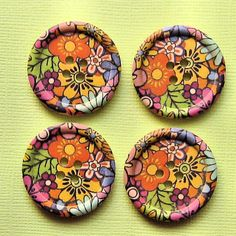 6 Large Wood Buttons Floral Designs 30mm. $2.50, via Etsy.