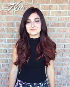 Transformed this brown balayage into a rich dark cherry with bright red ends. Created by stylist Corin! www.colorsbykim.com