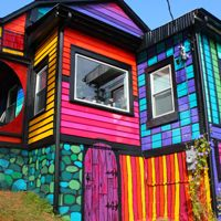 """Kat Wise: """"This is our crazy home, Calico, the House That Sweaters Built! It's been quite a renovation journey to get it to its psychedelic rainbow state."""" Wow!"""
