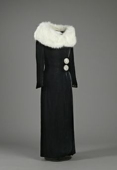 1930 - 1938 black coat with white fur around shoulders