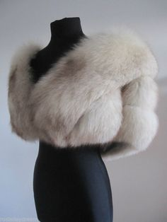 Crafted from heavenly soft and poofy Norwegian blue fox fur in cream dusted with cocoa and mocha, this hot little number features a pale silver satin lining, horizontal design, and one-hook closure. Fur Skirt, Wedding Fur, Fur Cape, Fur Accessories, Fabulous Furs, Fur Stole, Vintage Fur, Fur Fashion, Ivory White