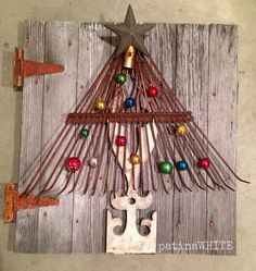 An outdoor tree made from a metal rake. Love this idea!