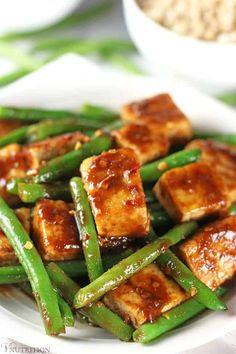 Tofu Green Bean Stir Fry | This Tofu Green Bean Stir Fry is easy to make, healthy, and delicious. It's vegan, gluten-free, and doesn't contain MSG like you'd get from many local takeout places. Have the takeout without the guilt! gluten-free, dairy-free, vegan recipe, vegetarian, tofu stir fry, vegan stir fry