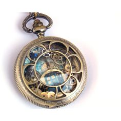 "Doctor Who Pocket Watch Necklace ""Solar Storm"" ($51) ❤ liked on Polyvore featuring jewelry, necklaces, brass necklace, galaxy necklace, cosmic jewelry, chain pocket watch and galaxy jewelry"