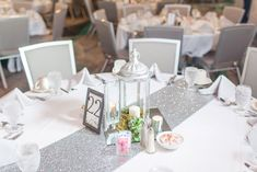 Loved it! Pinned it! A Blooming Envy Design! Photo by Ashlea Snell Photography. Silver Lantern with Candles, Succulents and Moss.