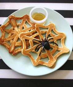 You've done Mickey Mouse pancakes, but this is a whole other ballgame. Let your kids eat these spider webs pull-apart style with a small side of syrup for easy dipping. Get the recipe from Mama. Papa Related: 12 Delicious Halloween Cocktails - Redbook.com