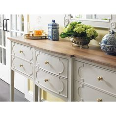 Six slender drawers adorned with astragal-shaped moulding are coupled with the refined arc of a bowed front to make the Drayton Sideboard the crown jewel of any dining room. It has six drawers and one blue silver liner in the center drawer. | Stanley Furniture