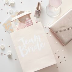 These gorgeous party bags are part of the Team Bride hen party range. Why not pop in a Team Bride badge or Glasses - both part of the stunning Team Bride Range. 'Team Bride' Party Bags x Hen Party Favours, Hen Party Gifts, Hen Party Bags, Party Gift Bags, Team Bride, Classy Hen Party, Paper Party Bags, Paper Bags, Pochette Surprise