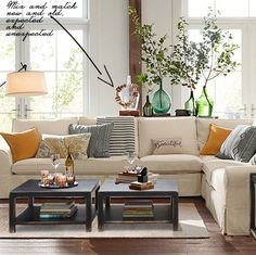 Pottery Barn 2015 Spring Living Room Display Tip, mix and match new and old, expected and unexpected for a surprisingly beautiful display, staggered heights of bottles