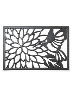 "Hummingbird Rubber Doormat by Abbott Collection. $20.99. Material: RUBBER. Color: BLACK. Size: 0.5"" H x 29.7"" L x 19.8"" W. You get 1 Piece. Made In India. The dainty hummingbird hovers over a summer dahlia. Contemporary styling balances negative space and the medium of rubber to create a ""workhorse"" rubber doormat. Mat is made in India of 100% natural rubber, treated to prevent fading.Hose clean with water or wash with a wet sponge. Measures approximately 20"" x 30""."