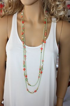 Long, Bright Green and Reddish Orange Beaded Necklace, Multi Strand with Gold Plated Metal Necklace. $49.90, via Etsy.